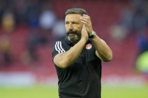 Aberdeen manager Derek McInnes hailed his players' character after they shrugged off an early setback to progress in the Europa League qualifiers.