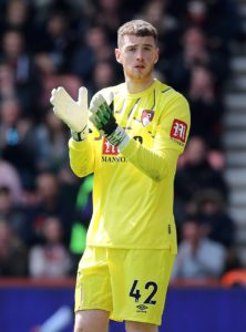 Bournemouth goalkeeper Mark Travers says he is 'delighted' to have put pen to paper on a 'long-term' contract.
