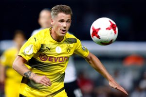 Borussia Dortmund defender Lukasz Piszczek says it is possible he will carry on playing after this season when his contract expires.