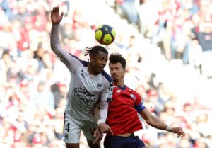 Sevilla have completed the signing of Bordeaux central defender Jules Kounde in a club-record deal.