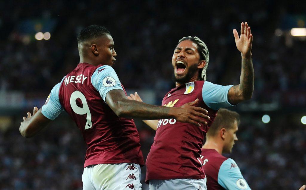 Wesley celebrates his goal for Aston Villa with Douglas Luiz