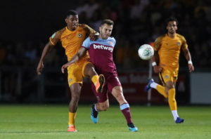 Jack Wilshere's first West Ham goal helped the Premier League side to a 2-0 win at Newport County in the Carabao Cup on Tuesday night.