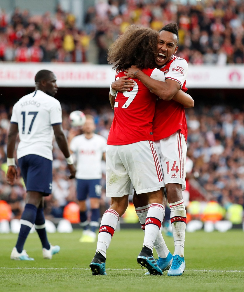 Arsenal fought back from two goals down to earn a 2-2 draw against Tottenham Hotspur in the North London derby at the Emirates Stadium.