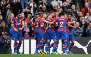 Crystal Palace have moved into the top half of the Premier League standings with a routine 2-0 victory over Norwich at Selhurst Park on Saturday.