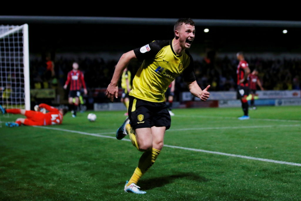 Bournemouth crashed out of the Carabao Cup after a 2-0 defeat at League One Burton Albion in a game interrupted by three power failures at the Pirelli Stadium.