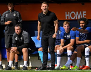 Luton Town boss Graeme Jones has called for the club's fans to back the team after learning many left early during their 3-2 defeat to Queens Park Rangers.