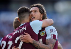 Jeff Hendrick was Burnley's hero at the Amex Stadium after firing a stoppage-time leveller to give his side a share of the spoils.