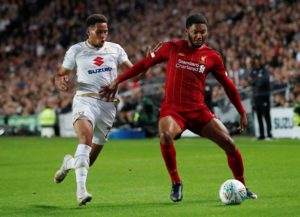 Liverpool defender Joe Gomez knows he will have to bide his time in order to get a regular run out for trophy chasing Liverpool.