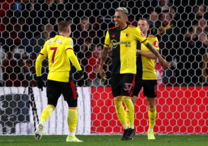 Watford sealed their first win of Quique Sanchez Flores' second spell in charge with a 2-1 victory over Swansea in the Carabao Cup third round at Vicarage Road.