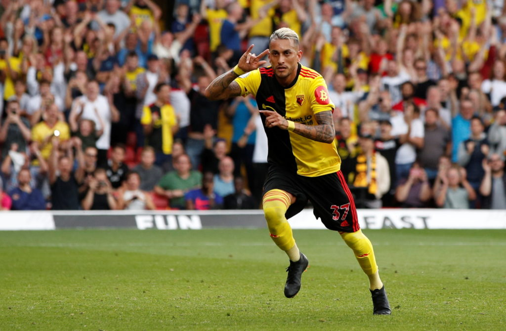 Watford stormed back from two-down to secure a deserved 2-2 draw against Arsenal in Quique Sanchez Flores' first game back in charge at Vicarage Road.