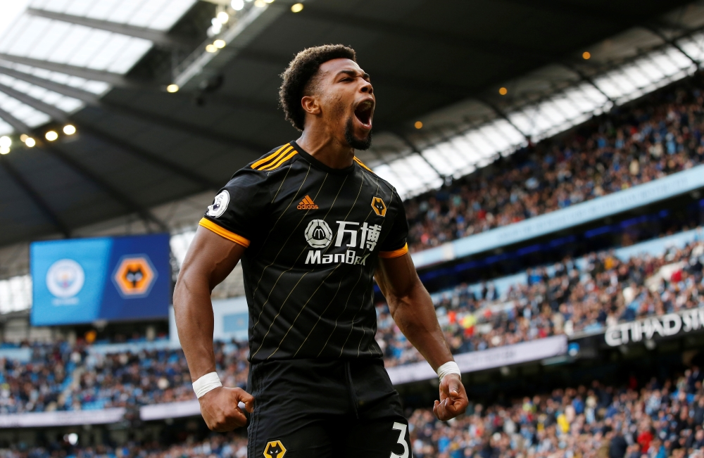 Manchester City are eight points behind Premier League leaders Liverpool after slipping to a shock 2-0 home loss to Wolves.