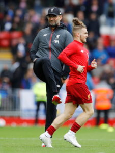 Liverpool's Harvey Elliott has been handed a 14-day ban from domestic club football for using offensive language in a social media post mocking Harry Kane.