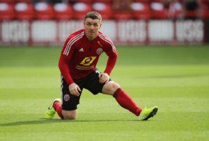 Sheffield United boss Chris Wilder feels John Fleck fully deserves his place in Steve Clarke's Scotland squad.