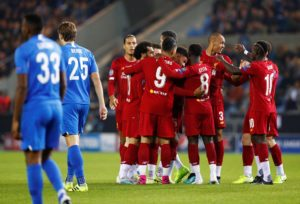 Liverpool eased to a 4-1 Champions League win away to Belgian champions Genk, with Alex Oxlade-Chamberlain scoring two of the goals.