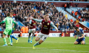 Matt Targett scored a late winner as Aston Villa beat 10-man Brighton 2-1 at Villa Park.