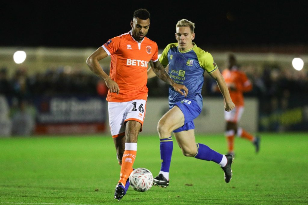 Ten-man Blackpool secured a hard-earned point from a closely-fought goalless draw with Burton at the Pirelli Stadium.