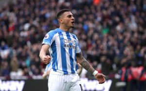 Huddersfield climbed out of the relegation zone with a battling 2-1 Yorkshire derby victory at home to Barnsley.