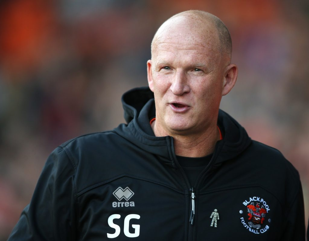 Blackpool manager Simon Grayson hailed his side's determination after they secured a hard-earned point from a goalless draw with Burton.
