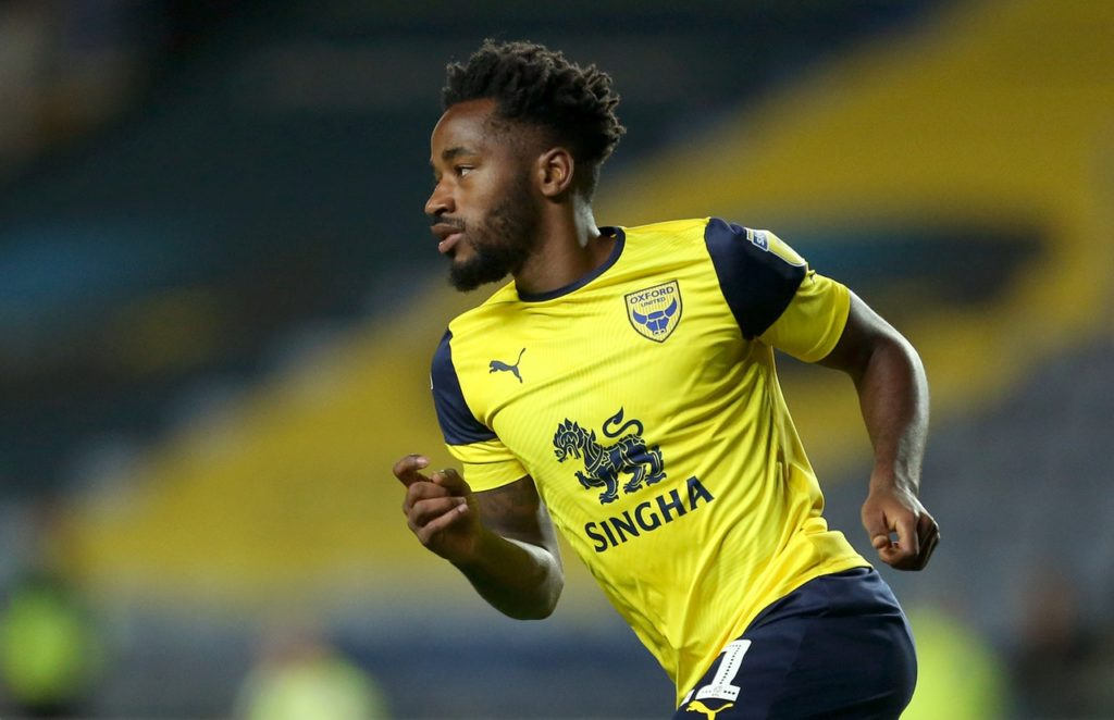Oxford extended their unbeaten league run to eight games with another classy win - 3-0 at home to 10-man Rochdale.