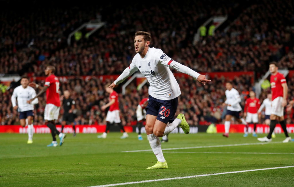 Adam Lallana's late goal rescued Liverpool a point at Manchester United as their winning start to the Premier League season came to an end at Old Trafford.