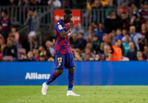 Barcelona romped to a 4-0 victory over Seviila but boss Ernesto Valverde hit out at the referee for sending off two of his players late on.