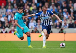 Defender Dan Burn believes Brighton are in a false position in the Premier League as they've not always got the results their performances have deserved.