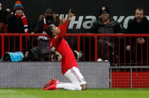 Odion Ighalo celebrates scoring on his first start for Manchester United