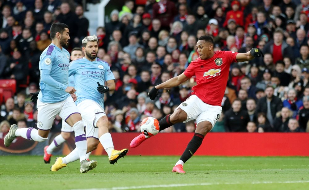 Anthony Martial scores the first goal against Manchester City
