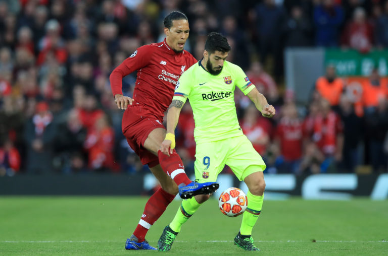 Liverpool's Virgil van Dijk (left) and Barcelona's Luis Suarez battle for the ball during the UEFA Champions League Semi Final, second leg match at Anfield, Liverpool