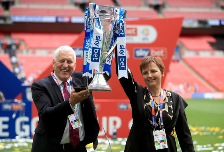 Mark Palios and Nicola Palios celebrate winning the Sky Bet League Two play-off final last year