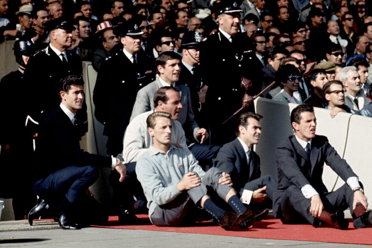 Norman Hunter (top) watches the 1966 World Cup final from the sidelines