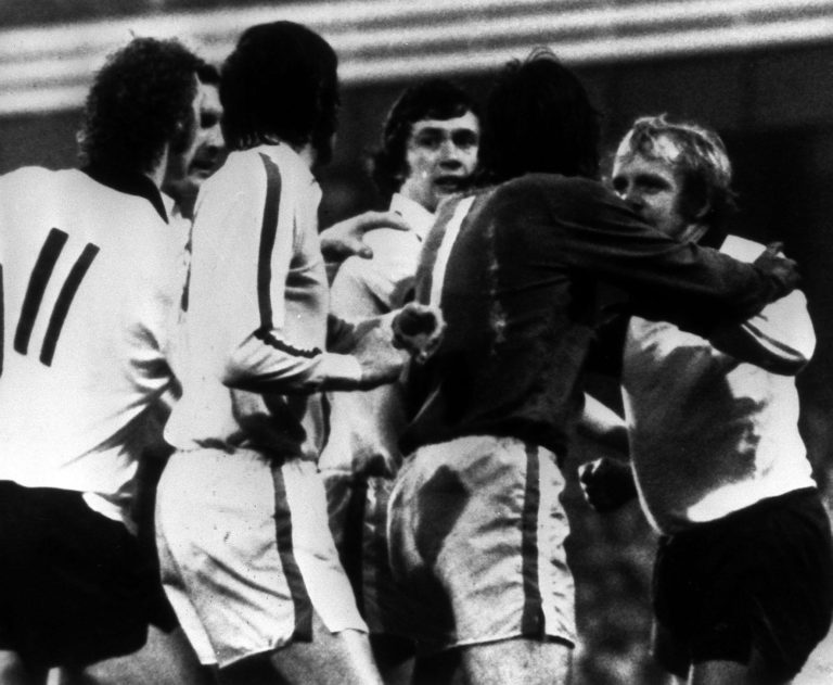 Norman Hunter and Derby's Francis Lee are separated by Leeds goalkeeper David Harvey (dark shirt) after they had exchanged blows