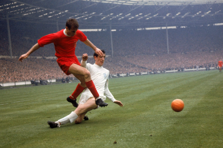 Hunter, right, challenges Liverpool forward Roger Hunt during the 1965 FA Cup final at Wembley