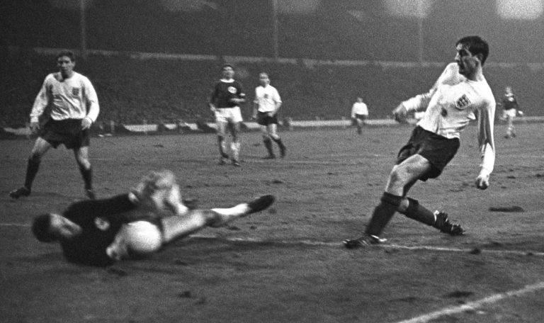 West Germany goalkeeper Hans Tilkowski denies Hunter during an international friendly in February 1966