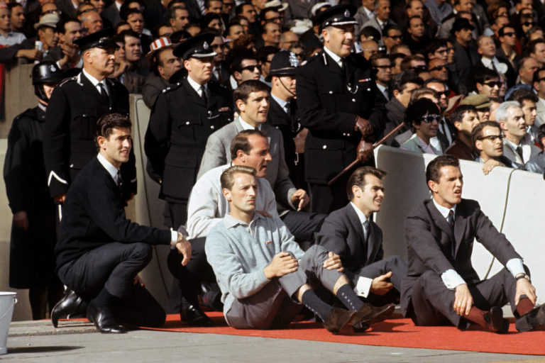 Norman Hunter looks on along with other non-playing reserves during the 1966 World Cup final at Wembley