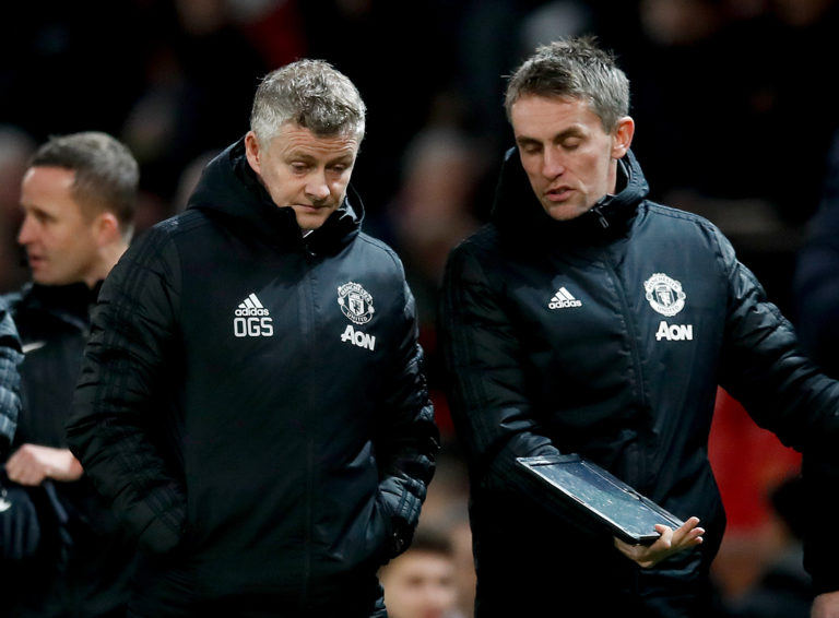 Kieran McKenna, right, says Manchester United are working on the premise that they can return to some form of training next month (Martin Rickett/PA)