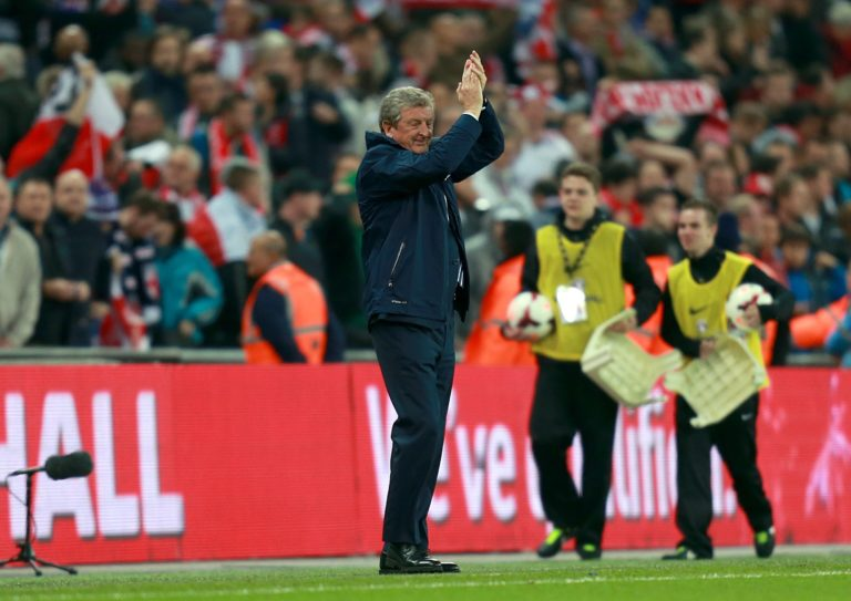 Roy Hodgson applauds England's fans after sealing World Cup qualification