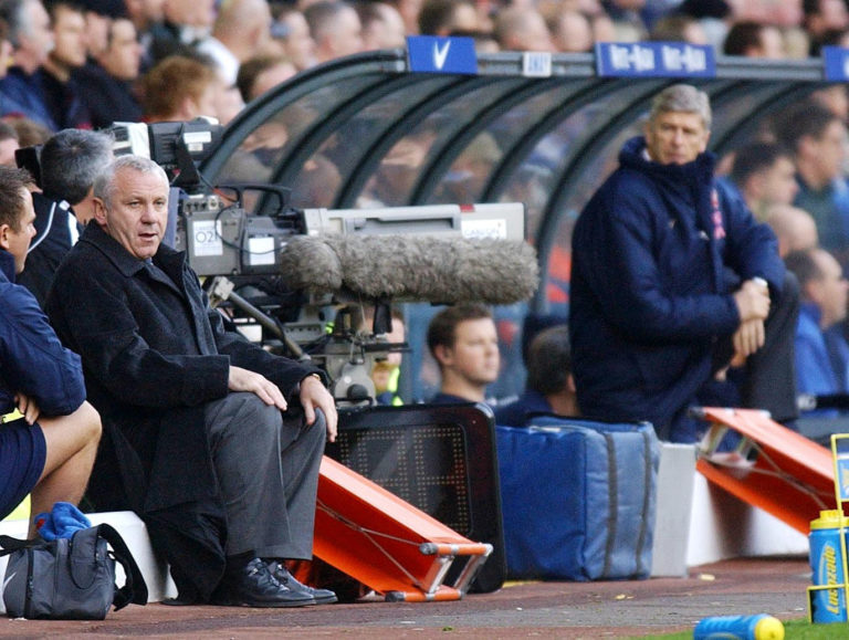 Arsene Wenger (right) watches on