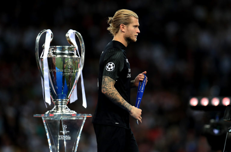 Loris Karius walks past the Champions League trophy following Liverpool's loss to Real Madrid in 2018
