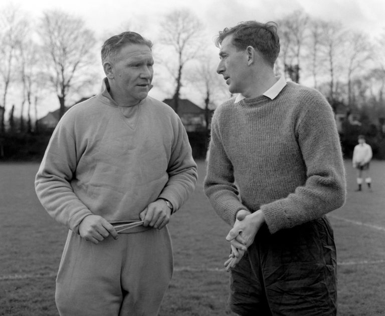 Tottenham manager Bill Nicholson and captain Danny Blanchflower during a training session at Cheshunt, Hertfordshire