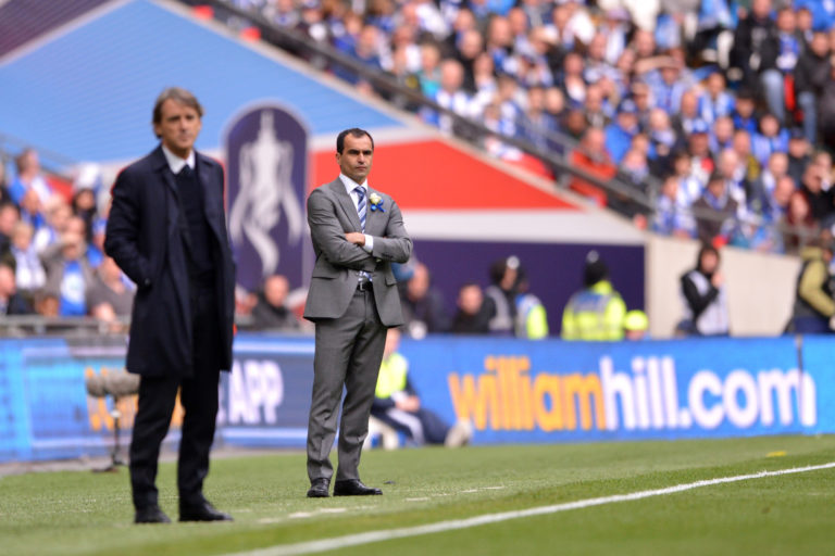 Roberto Mancini, left, and Roberto Martinez suffered different fates after the game