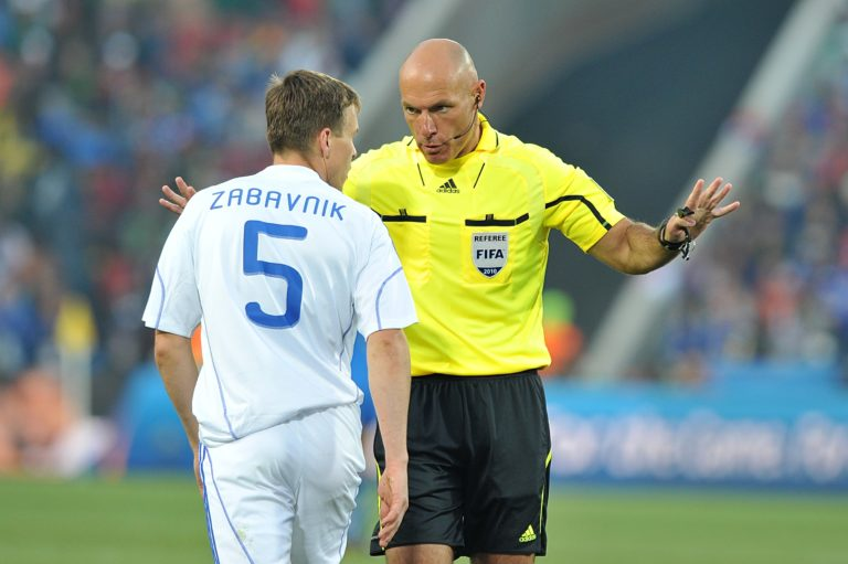 Match referee Howard Webb disciplines Slovakia's Radoslav Zabavnik (left)