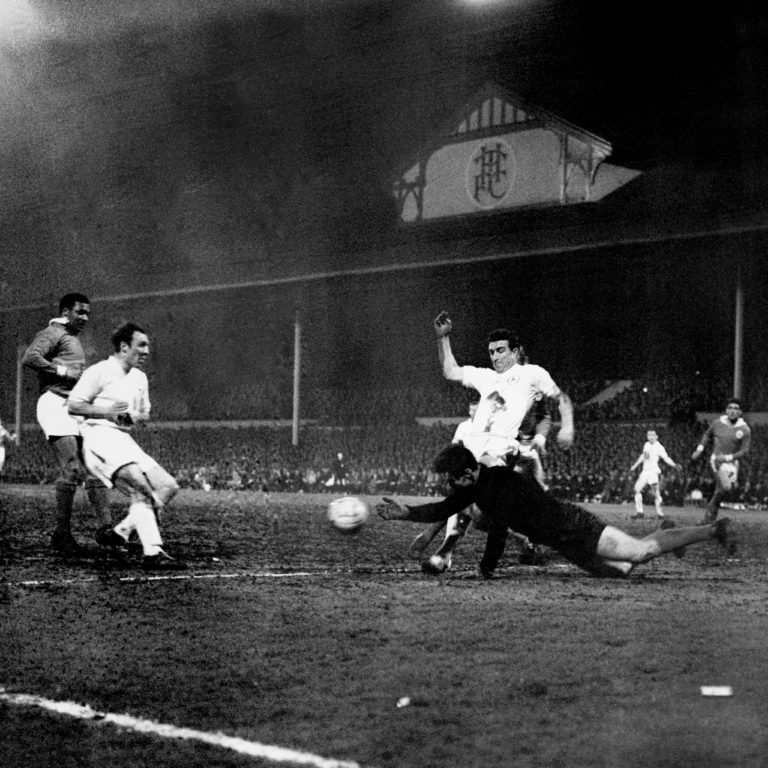The Benfica goalkeeper dives at the feet of Spurs attackers Jimmy Greaves (left) and Bobby Smith in the European Cup semi-finals
