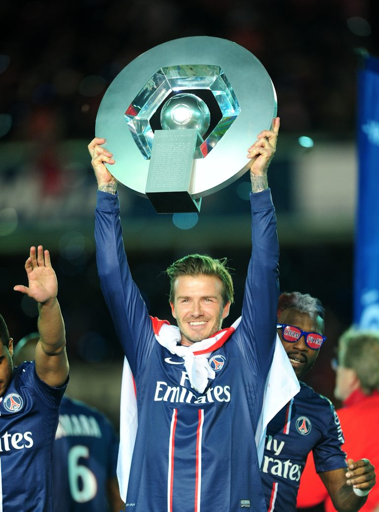 David Beckham celebrates with the Ligue 1 trophy
