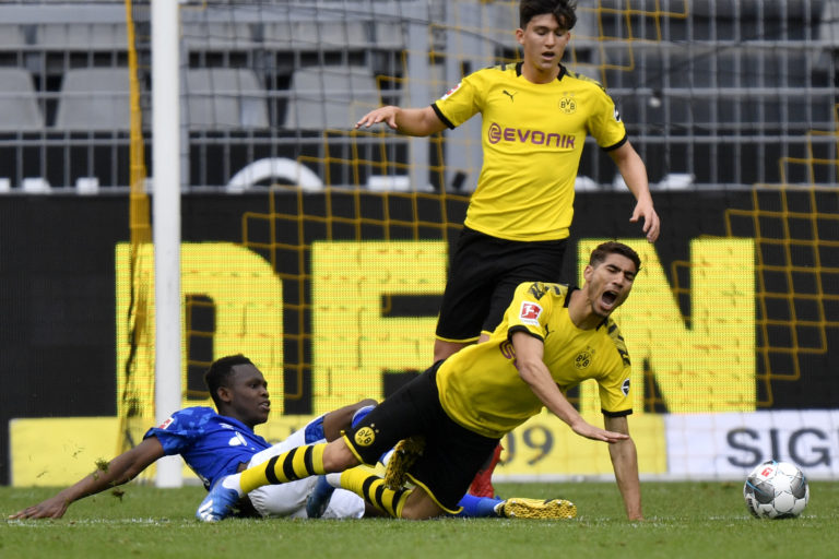 Rabbi Matondo fouls Dortmund's Achraf Hakimi towards the end of play