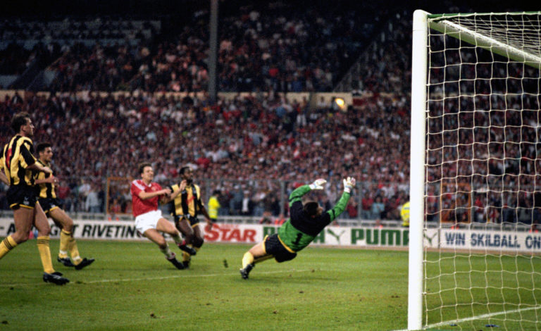 Manchester United's Lee Martin fires the winning goal past Crystal Palace goalkeeper Nigel Martyn