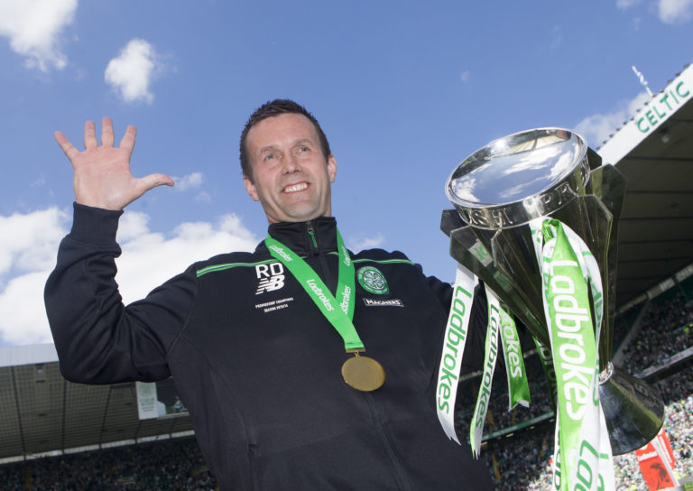 Ronny Deila with the Premiership trophy after a 7-0 win over Motherwell in his last game