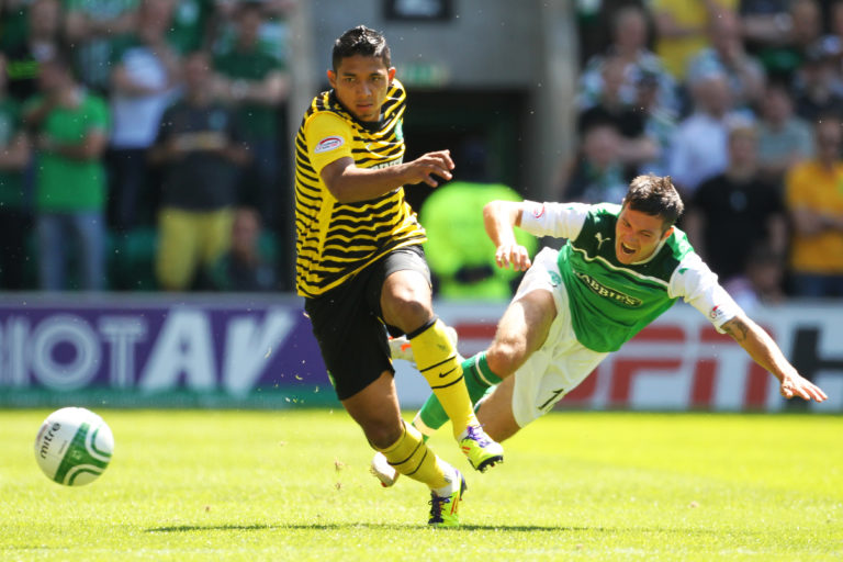 Emilio Izaguirre comes out on top against Hibernian's Ivan Sproule