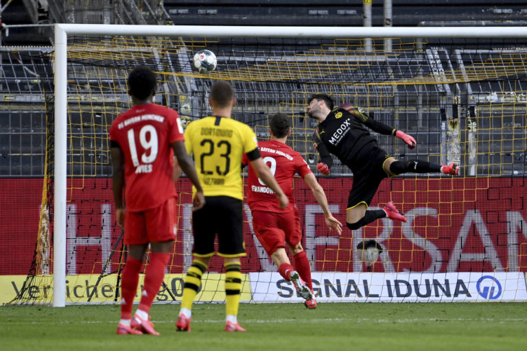 Dortmund goalkeeper Roman Burki is beaten by Joshua Kimmich