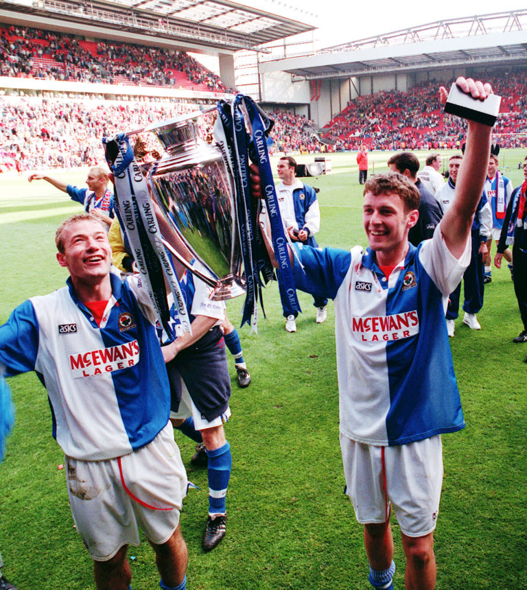 Shearer and Sutton celebrate the title